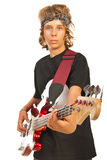 Younger male playing bass guitar Royalty Free Stock Image