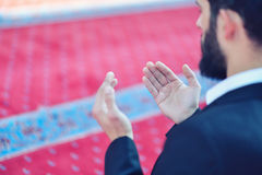 Younger Muslim man praying in colorful mosque Royalty Free Stock Image