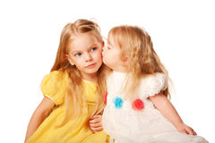 Younger sister kissing elder sister. Royalty Free Stock Photos