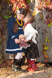 Younger sister whispers secrets older sister Royalty Free Stock Photo
