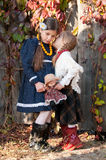Younger sister whispers secrets older sister Royalty Free Stock Images