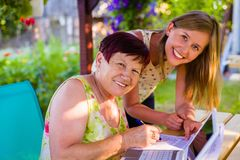 Younger teaches older Stock Photography