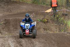 The youngest participant. SERPUKHOV, RUSSIA - OCTOBER 7, 2017: Volostnykh Boris 24,  Class ATV-JUNIORS, in the 4 stage  MX series, the Red Wings Cup 2017 super Stock Images