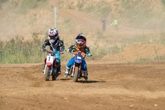 The youngest participants in the race. MOSCOW, RUSSIA - SEPTEMBER 15, 2018: Unrecognized young athletes,in the Velyaminovo Race Weekend 2018, Motopark stock image