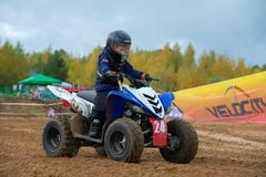 The youngest sportsman. SERPUKHOV, RUSSIA - OCTOBER 7, 2017: Volostnykh Boris 24,  Class ATV-JUNIORS, in the 4 stage  MX series, the Red Wings Cup 2017 super Royalty Free Stock Images