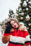 Younggirl on the red Square through winter holiday in Moscow, stylish and beautiful posing near to Christmas tree royalty free stock photos