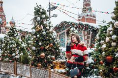 Younggirl on the red Square through winter holiday in Moscow, stylish and beautiful posing near to Christmas tree stock photography