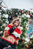 Younggirl on the red Square through winter holiday in Moscow, stylish and beautiful posing near to Christmas tree stock image