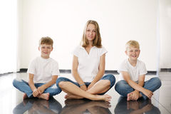 Youngl girl with brothers Royalty Free Stock Images