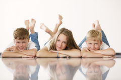 Youngl girl with brothers Stock Photos