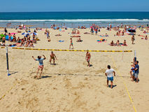 Youngs mens playing volleyball in Zurriola beach, San Sebastian. Spain. Royalty Free Stock Images