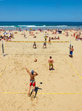 Youngs mens playing volleyball in Zurriola beach, San Sebastian. Spain. Stock Image