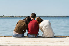 Youngs on pier Stock Photos