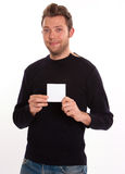 Youngster with blank card Royalty Free Stock Photography