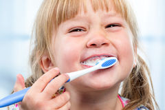 Youngster having fun brushing teeth. Royalty Free Stock Photo