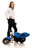 Youngster with her pocketbike Royalty Free Stock Photos