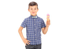 Youngster holding an ice cream cone Stock Images