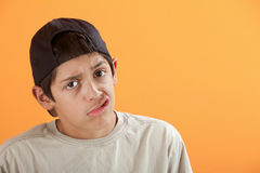 Youngster Makes Faces. Latino kid making funny faces with his mouth Royalty Free Stock Photography