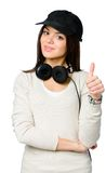 Youngster in peaked cap thumbs up Royalty Free Stock Photo
