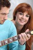 Youngster playing the guitar. For his girlfriend Stock Photos