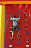 Youngster's effort in climbing Stock Photo