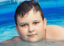 Youngster in swimming pool Stock Image