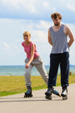 Youngsters together skating in seafront park. Royalty Free Stock Photo