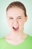 Youngwoman que grita con cólera Imágenes de archivo libres de regalías