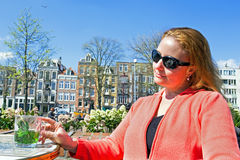Yount dutch woman drinking mint tea in Amsterdam Netherlands Stock Photo