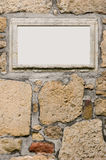 Your add here. Old wall with stone frame royalty free stock images