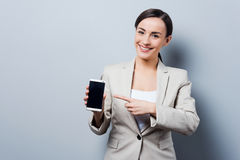 Your advertising on her phone. Royalty Free Stock Photography
