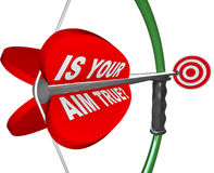 Is Your Aim True? Question on Bow and Arrow Target. A red arrow is marked Is Your Aim True asking if you are confident and sure in your aiming on a target Royalty Free Stock Images