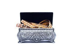 luxury gold bracelet in the opened silver antique chest Royalty Free Stock Photo