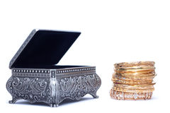 of luxury gold bracelet with an opened silver chest Royalty Free Stock Image