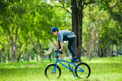 Your boy performing trick on bicycle outdoors Royalty Free Stock Images