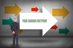 Your carbon footprint against arrows pointing Stock Photography