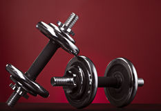 Your challenge. Contrasting shiny dumbbell on a red background Royalty Free Stock Photography