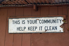 This Is Your Community Help Keep It Clean. Sign reads this is your community help keep it clean on a decaying wood board Royalty Free Stock Photos