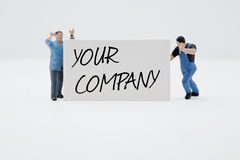 Your company. Two men holding a sign Stock Photo