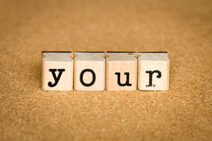 Your Concept. Alphabet stamp on a cork board Royalty Free Stock Images