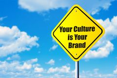 Your culture is your brand. Road sign and blue sky royalty free stock image