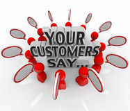 Your Customers Say Satisfaction Feedback Happiness Rating. The words Your Customers Say surrounded by people and speech bubbles to illustrate feedback and Royalty Free Stock Image