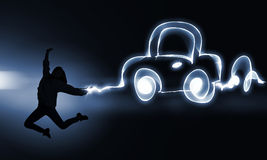 Your dream car. Young girl jumping high in sky representing youth concept Royalty Free Stock Photo
