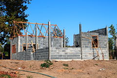 Your dream home. New residential construction house framing against a blue sky. Royalty Free Stock Photos