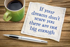 Your dreams are not big enough. If your dreams don`t scare, there are not big enough - handwriting on a napkin with a cup of espresso coffee stock image