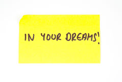 'In Your Dreams!' written on a sticky note Stock Image