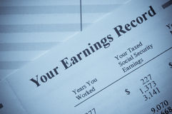 Your Earnings Record. Statement of earnings and social security taxes royalty free stock images