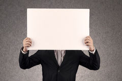 Your empty board. Businessperson with blank board that you can write anything Stock Image