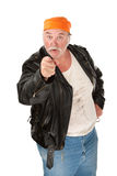 In Your Face. Angry biker gang member with leather jacket Royalty Free Stock Photography