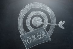 Your goal is an inscription with a target on the board. The concept of winning in business and achieving the goal.  royalty free stock photo